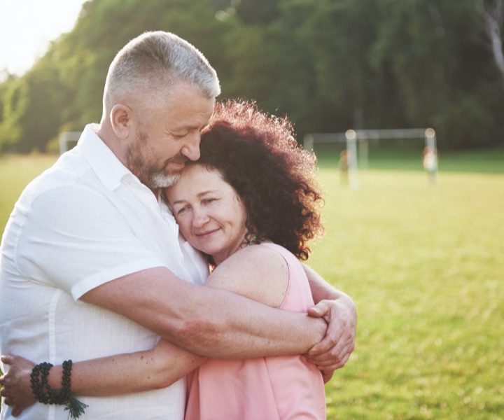A woman in relapse hugs her partner during recovery