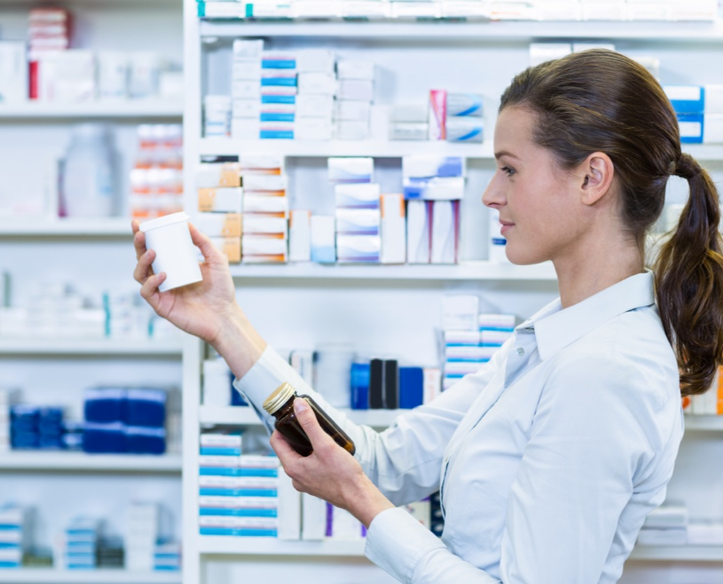Pharmacist looking at medications for medication-assisted addiction treatment